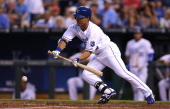 Norichika Aoki of the Kansas City Royals drops down a bunt in the fourth inning against the Minnesota Twins at Kauffman Stadium on July 29 2014 in...