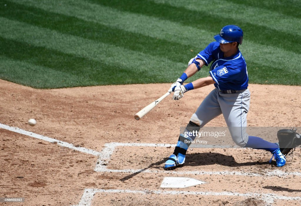 Norichika Aoki #23 of the Kansas City Royals hits a single during the fourth inning of a baseball game against the San Diego Padres at Petco Park May 7, 2014 in San Diego, California.