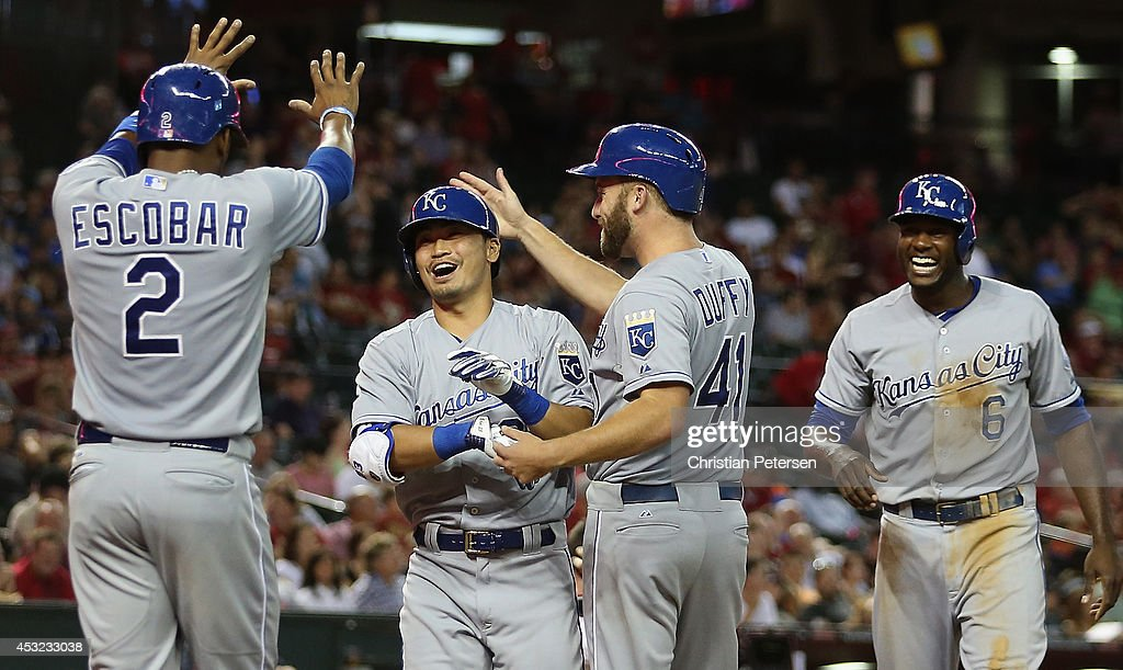 <a gi-track='captionPersonalityLinkClicked' href=/galleries/search?phrase=Norichika+Aoki&family=editorial&specificpeople=850957 ng-click='$event.stopPropagation()'>Norichika Aoki</a> #23 of the Kansas City Royals is congratulated by <a gi-track='captionPersonalityLinkClicked' href=/galleries/search?phrase=Alcides+Escobar&family=editorial&specificpeople=4845889 ng-click='$event.stopPropagation()'>Alcides Escobar</a> #2, <a gi-track='captionPersonalityLinkClicked' href=/galleries/search?phrase=Danny+Duffy&family=editorial&specificpeople=5971971 ng-click='$event.stopPropagation()'>Danny Duffy</a> #41 and <a gi-track='captionPersonalityLinkClicked' href=/galleries/search?phrase=Lorenzo+Cain&family=editorial&specificpeople=5746615 ng-click='$event.stopPropagation()'>Lorenzo Cain</a> #6 after Aoki hit a grand slam against the Arizona Diamondbacks during the fifth inning of the MLB game at Chase Field on August 5, 2014 in Phoenix, Arizona.
