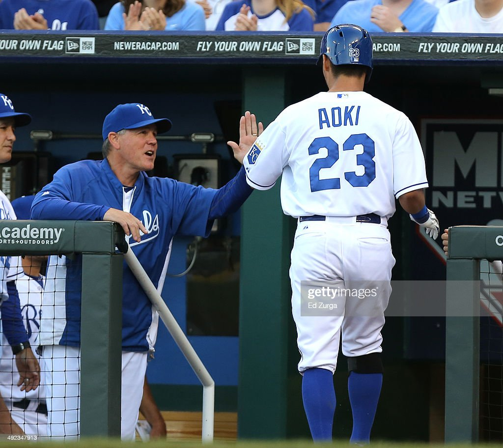 <a gi-track='captionPersonalityLinkClicked' href=/galleries/search?phrase=Norichika+Aoki&family=editorial&specificpeople=850957 ng-click='$event.stopPropagation()'>Norichika Aoki</a> #23 of the Kansas City Royals is congratulated by manager <a gi-track='captionPersonalityLinkClicked' href=/galleries/search?phrase=Ned+Yost&family=editorial&specificpeople=228571 ng-click='$event.stopPropagation()'>Ned Yost</a> #3 after scoring on a Eric Hosmer double in the first inning against the Chicago White Sox at Kauffman Stadium on May 19, 2014 in Kansas City, Missouri.