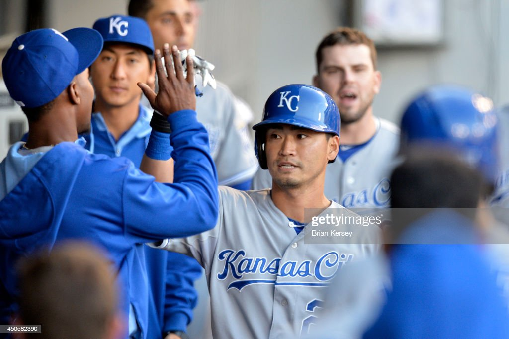 Norichika Aoki #23 of the Kansas City Royals is greeted in the dugout by his teammates after scoring on a sacrifice fly hit by Eric Hosmer during the second inning against the Chicago White Sox at U.S. Cellular Field on June 13, 2014 in Chicago, Illinois.