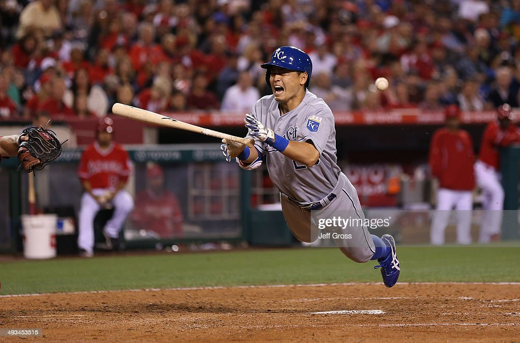 Norichika Aoki #23 of the Kansas City Royals is hit by a pitch in the seventh against the Los Angeles Angels of Anaheim at Angel Stadium of Anaheim on May 23, 2014 in Anaheim, California.