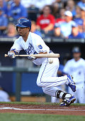 Norichika Aoki of the Kansas City Royals is out on a bunt foul in the first inning against the Cleveland Indians at Kauffman Stadium on July 26 2014...