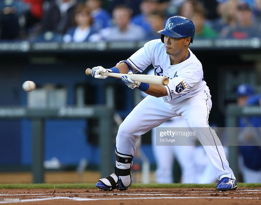 Norichika Aoki of the Kansas City Royals looks to bunt in the first inning against the Boston Red Sox at Kauffman Stadium on September 13 2014 in...
