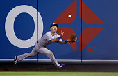 Norichika Aoki of the Kansas City Royals makes a catch in the seventh inning against the Los Angeles Angels during Game One of the American League...