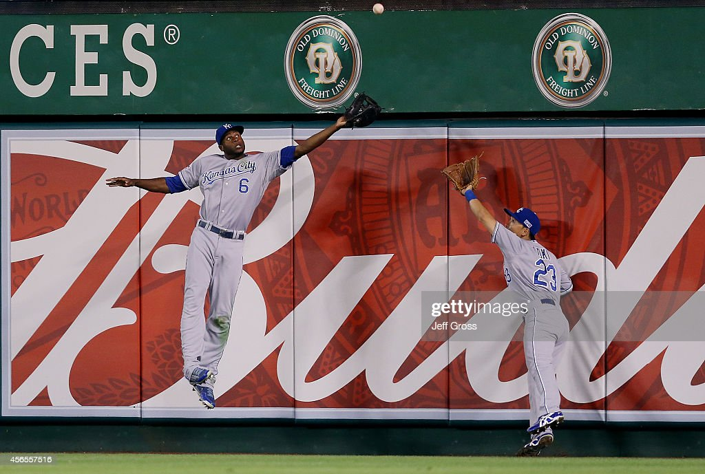 Norichika Aoki of the Kansas City Royals makes a catch in the sixth inning against the Los Angeles Angels during Game One of the American League...