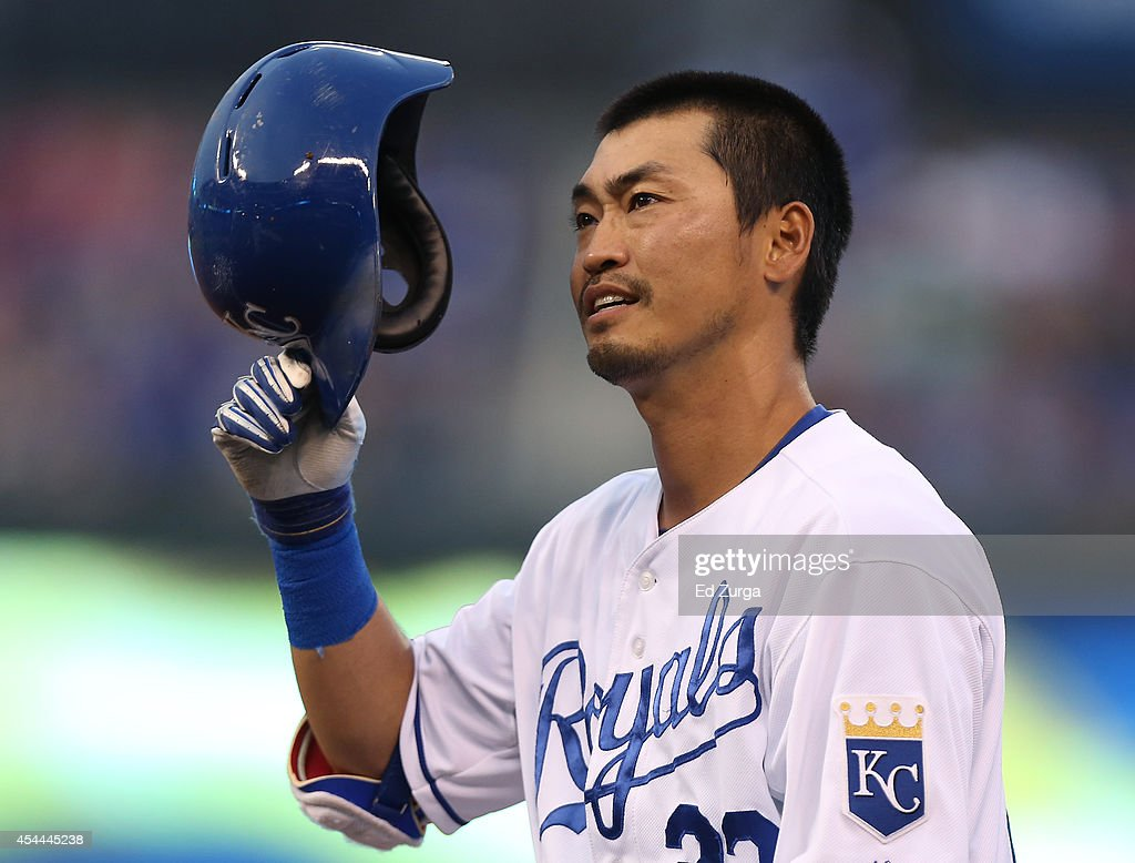 Norichika Aoki #23 of the Kansas City Royals puts his helmet back on as he heads back to first after hitting a single in the first inning against the Cleveland Indians at Kauffman Stadium on August 31, 2014 in Kansas City, Missouri.