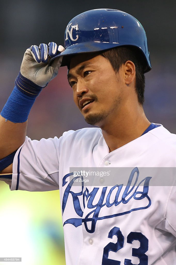 <a gi-track='captionPersonalityLinkClicked' href=/galleries/search?phrase=Norichika+Aoki&family=editorial&specificpeople=850957 ng-click='$event.stopPropagation()'>Norichika Aoki</a> #23 of the Kansas City Royals puts his helmet back on as he heads back to first after hitting a single in the first inning against the Cleveland Indians at Kauffman Stadium on August 31, 2014 in Kansas City, Missouri.