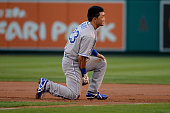 Norichika Aoki of the Kansas City Royals reacts after being picked off at first base against the Los Angeles Angels to end the first inning during...