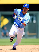 Norichika Aoki of the Kansas City Royals rounds second base on his way to third for a triple during the 7th inning of the game against the Oakland...