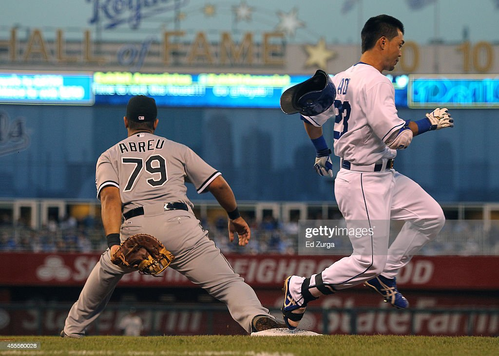 <a gi-track='captionPersonalityLinkClicked' href=/galleries/search?phrase=Norichika+Aoki&family=editorial&specificpeople=850957 ng-click='$event.stopPropagation()'>Norichika Aoki</a> #23 of the Kansas City Royals runs across first base past Jose Abreu #79 of the Chicago White Sox as he grounds out in the first inning at Kauffman Stadium on September 16, 2012 in Kansas City, Missouri.