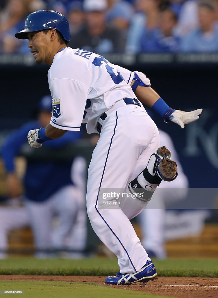 Norichika Aoki #23 of the Kansas City Royals runs to first after hitting a single in the third inning against the Oakland Athletics at Kauffman Stadium on August 12, 2014 in Kansas City, Missouri.
