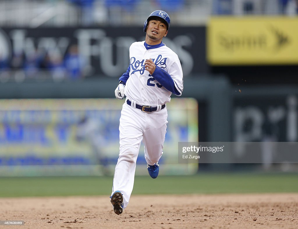 Norichika Aoki #23 of the Kansas City Royals runs to third after a ground out to end the seventh inning by Omar Infante in the seventh inning during a game against the Chicago White Sox in the home opener at Kauffman Stadium on April 4, 2014 in Kansas City, Missouri.