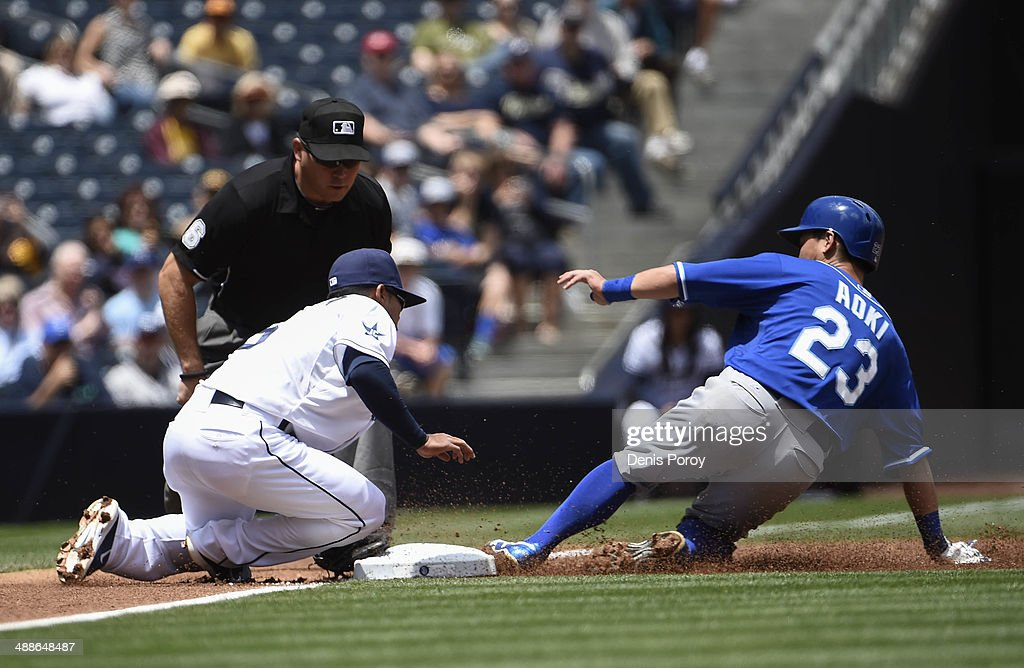 Norichika Aoki #23 of the Kansas City Royals steals third base in front of the tag of Alexi Amarista #5 of the San Diego Padres during the first inning of a baseball game at Petco Park May 7, 2014 in San Diego, California.