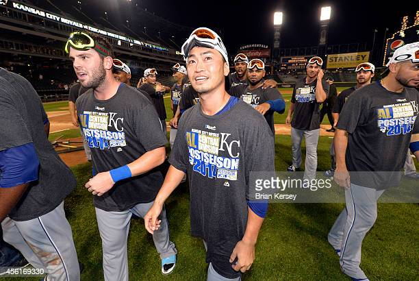 Norichika Aoki of the Kansas City Royals walks off the field with his teammates after defeating the Chicago White Sox to clinch a Wild Card berth at...