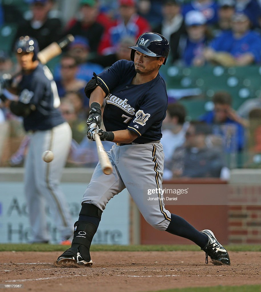<a gi-track='captionPersonalityLinkClicked' href=/galleries/search?phrase=Norichika+Aoki&family=editorial&specificpeople=850957 ng-click='$event.stopPropagation()'>Norichika Aoki</a> #7 of the Milwaukee Brewers bats against the Chicago Cubs during the Opening Day game at Wrigley Field on April 8, 2013 in Chicago, Illinois. The Brewers defeated the Cubs 7-4.