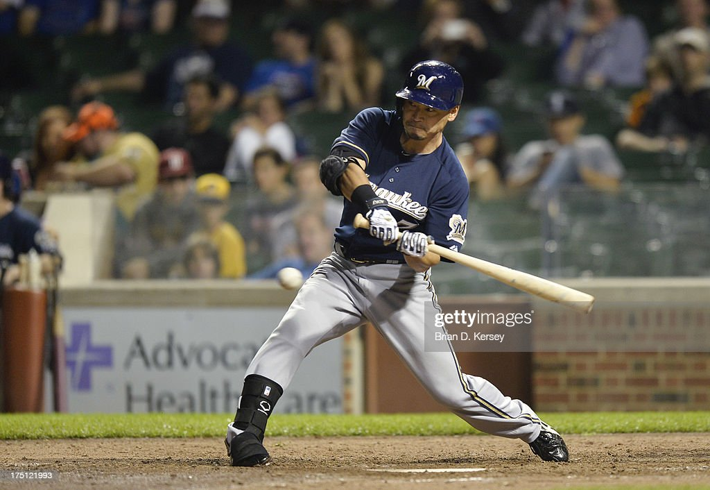 <a gi-track='captionPersonalityLinkClicked' href=/galleries/search?phrase=Norichika+Aoki&family=editorial&specificpeople=850957 ng-click='$event.stopPropagation()'>Norichika Aoki</a> #7 of the Milwaukee Brewers bats during the eighth inning against the Chicago Cubs at Wrigley Field on July 31, 2013 in Chicago, Illinois. The Cubs defeated the Brewers 6-1.