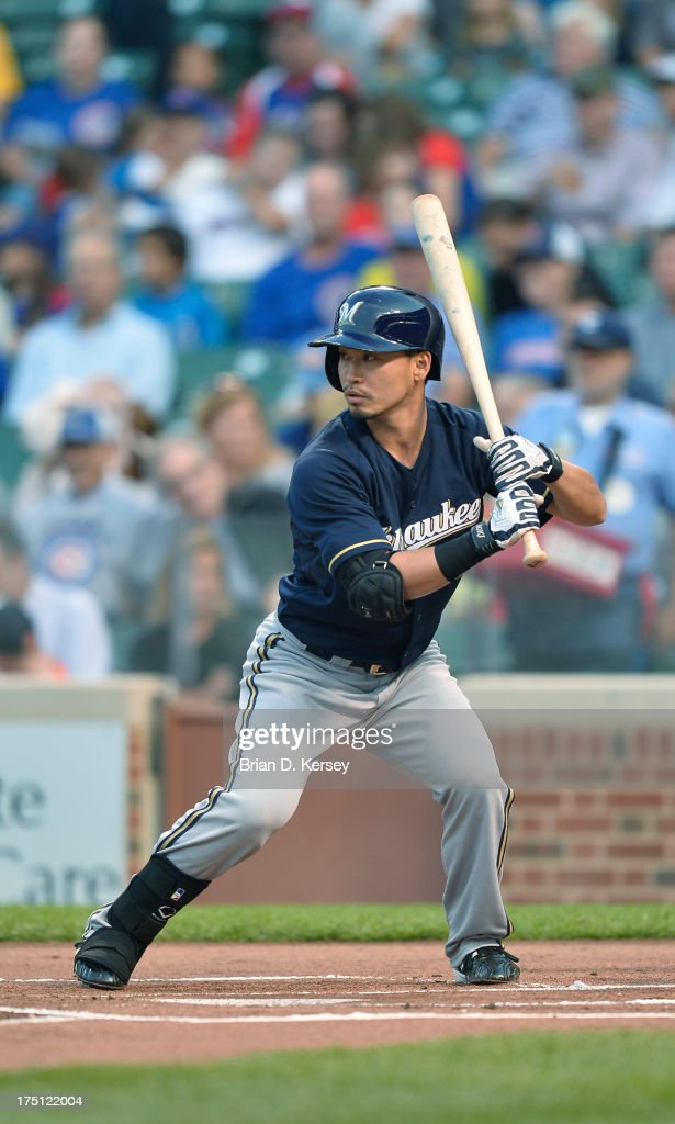<a gi-track='captionPersonalityLinkClicked' href=/galleries/search?phrase=Norichika+Aoki&family=editorial&specificpeople=850957 ng-click='$event.stopPropagation()'>Norichika Aoki</a> #7 of the Milwaukee Brewers bats during the first inning against the Chicago Cubs at Wrigley Field on July 31, 2013 in Chicago, Illinois. The Cubs defeated the Brewers 6-1.