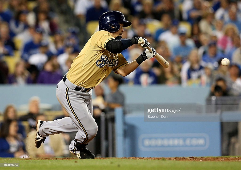 <a gi-track='captionPersonalityLinkClicked' href=/galleries/search?phrase=Norichika+Aoki&family=editorial&specificpeople=850957 ng-click='$event.stopPropagation()'>Norichika Aoki</a> #7 of the Milwaukee Brewers bunts for a single and reaches second on a throwing error in the seventh inning against the Los Angeles Dodgers at Dodger Stadium on April 27, 2013 in Los Angeles, California.
