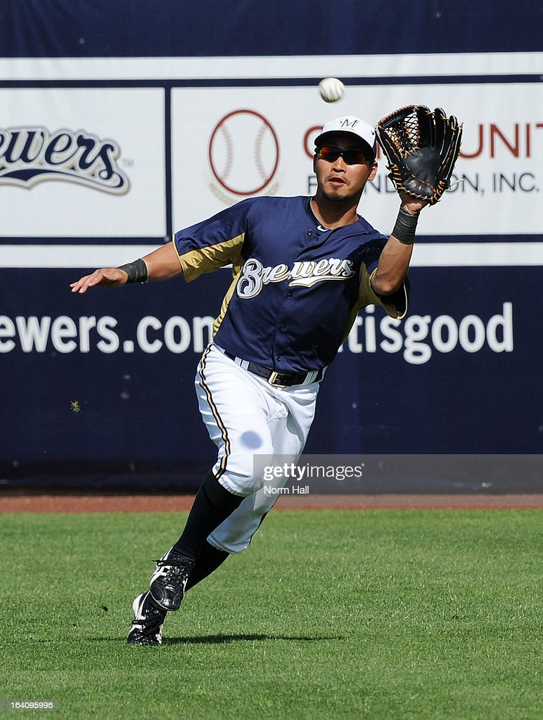 <a gi-track='captionPersonalityLinkClicked' href=/galleries/search?phrase=Norichika+Aoki&family=editorial&specificpeople=850957 ng-click='$event.stopPropagation()'>Norichika Aoki</a> #7 of the Milwaukee Brewers catches a line drive against the Los Angeles Angels of Anaheim at Maryvale Baseball Park on March 19, 2013 in Maryvale, Arizona.