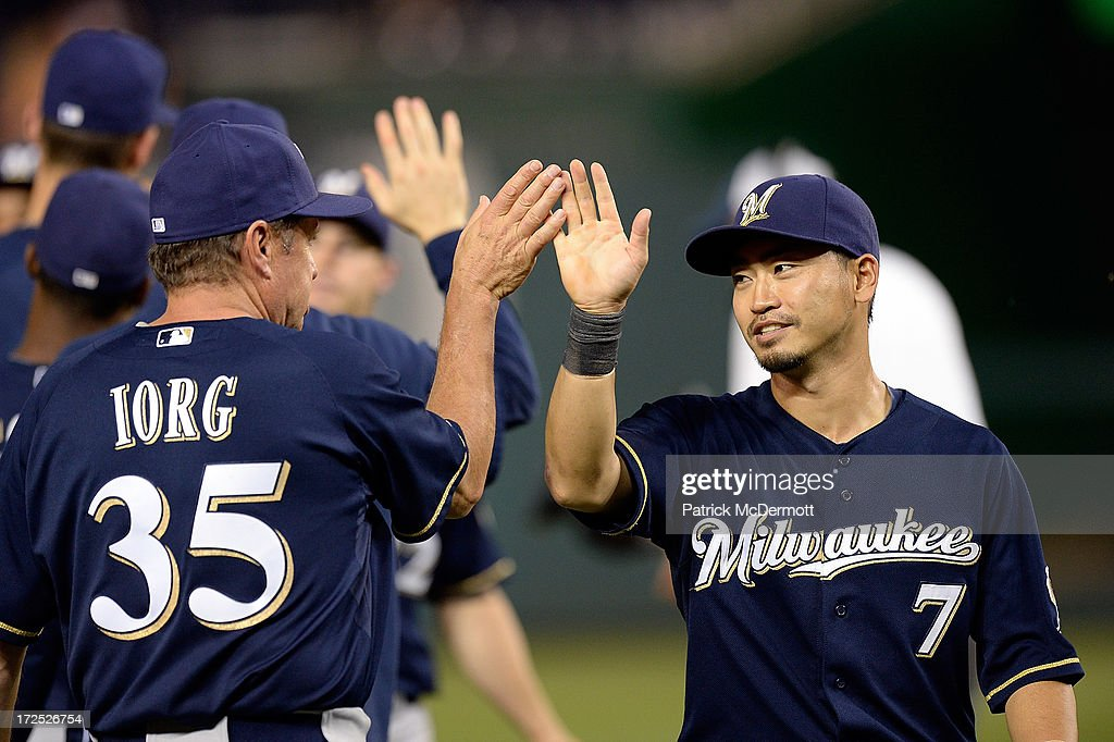 <a gi-track='captionPersonalityLinkClicked' href=/galleries/search?phrase=Norichika+Aoki&family=editorial&specificpeople=850957 ng-click='$event.stopPropagation()'>Norichika Aoki</a> #7 of the Milwaukee Brewers celebrates with Garth Iorg #35 after the Brewers defeated the Washington Nationals 4-0 during a game at Nationals Park on July 2, 2013 in Washington, DC.