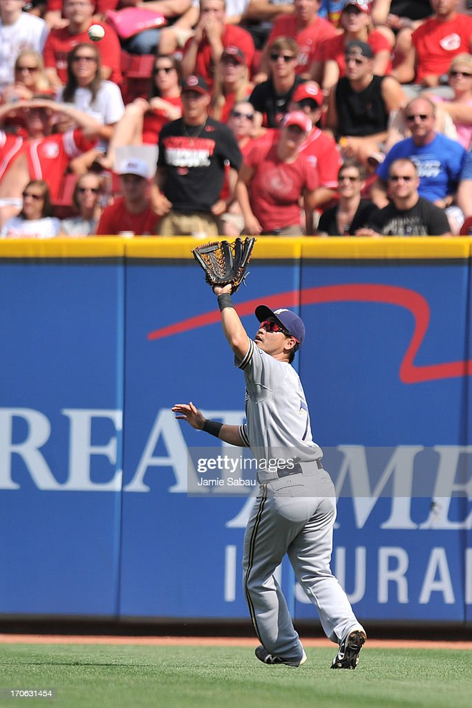 Norichika Aoki #7 of the Milwaukee Brewers chases down a fly ball in the second inning against the Cincinnati Reds at Great American Ball Park on June 15, 2013 in Cincinnati, Ohio. Milwaukee blanked Cincinnati 6-0.