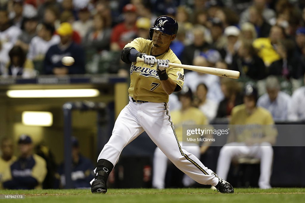 <a gi-track='captionPersonalityLinkClicked' href=/galleries/search?phrase=Norichika+Aoki&family=editorial&specificpeople=850957 ng-click='$event.stopPropagation()'>Norichika Aoki</a> #7 of the Milwaukee Brewers doubles in the bottom of the seventh inning against the St. Louis Cardinals at Miller Park on May 02, 2013 in Milwaukee, Wisconsin.