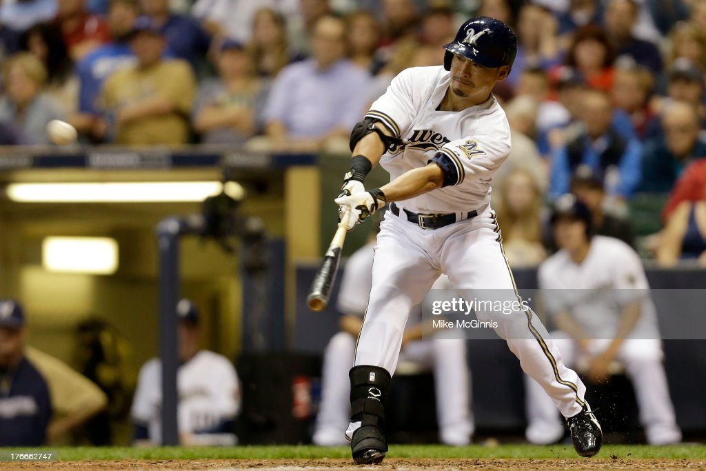 <a gi-track='captionPersonalityLinkClicked' href=/galleries/search?phrase=Norichika+Aoki&family=editorial&specificpeople=850957 ng-click='$event.stopPropagation()'>Norichika Aoki</a> #7 of the Milwaukee Brewers flies out to center field in the bottom of the sixth inning against the Cincinnati Reds at Miller Park on August 16, 2013 in Milwaukee, Wisconsin.