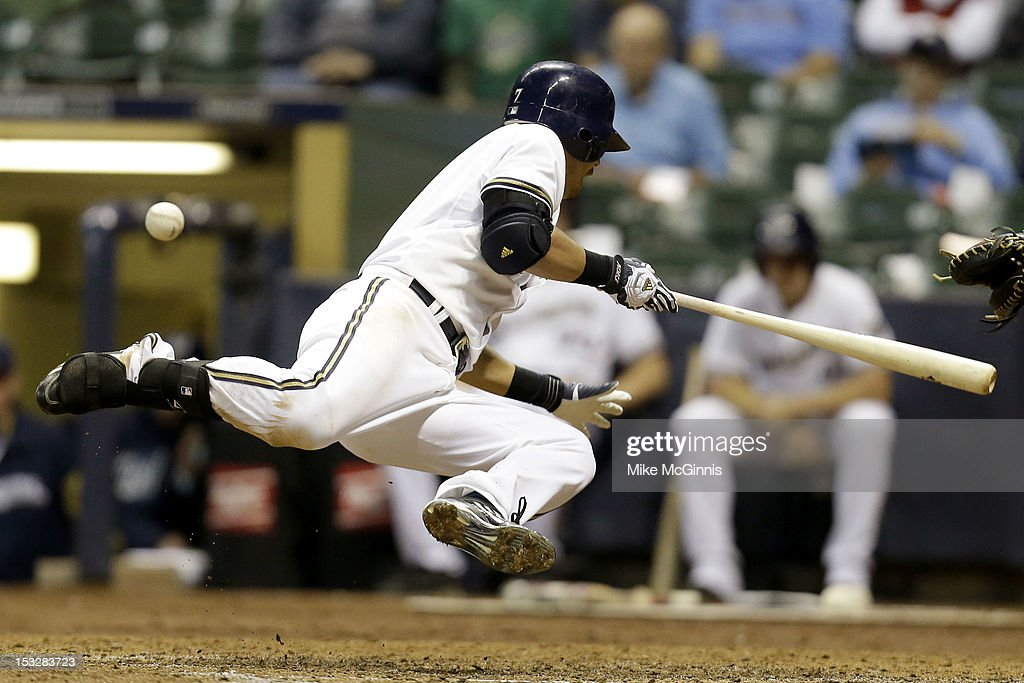 <a gi-track='captionPersonalityLinkClicked' href=/galleries/search?phrase=Norichika+Aoki&family=editorial&specificpeople=850957 ng-click='$event.stopPropagation()'>Norichika Aoki</a> #7 of the Milwaukee Brewers gets hit by a pitch by Tommy Layne of the San Diego Padres during the bottom of the seventh inning at Miller Park on October 2, 2012 in Milwaukee, Wisconsin.