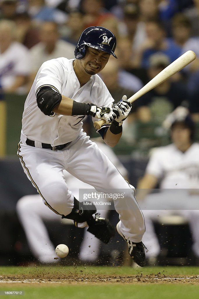 <a gi-track='captionPersonalityLinkClicked' href=/galleries/search?phrase=Norichika+Aoki&family=editorial&specificpeople=850957 ng-click='$event.stopPropagation()'>Norichika Aoki</a> #7 of the Milwaukee Brewers gets hit by a pitch in the bottom of the fifth inning against the Chicago Cubs at Miller Park on September 18, 2013 in Milwaukee, Wisconsin.