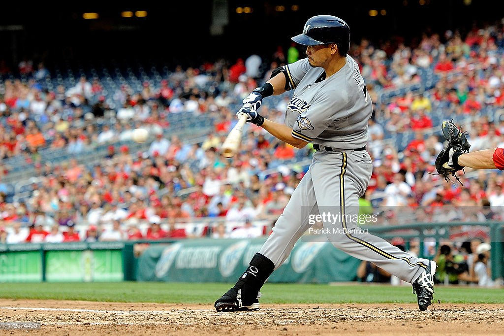 <a gi-track='captionPersonalityLinkClicked' href=/galleries/search?phrase=Norichika+Aoki&family=editorial&specificpeople=850957 ng-click='$event.stopPropagation()'>Norichika Aoki</a> #7 of the Milwaukee Brewers hits a two-run RBI single in the fifth inning during a game against the Washington Nationals at Nationals Park on July 3, 2013 in Washington, DC.