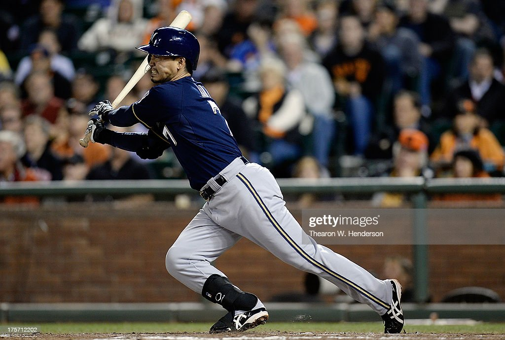<a gi-track='captionPersonalityLinkClicked' href=/galleries/search?phrase=Norichika+Aoki&family=editorial&specificpeople=850957 ng-click='$event.stopPropagation()'>Norichika Aoki</a> #7 of the Milwaukee Brewers hits into a double-play in the seventh inning against the San Francisco Giants at AT&T Park on August 6, 2013 in San Francisco, California.