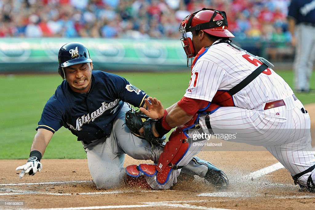 Norichika Aoki #7 of the Milwaukee Brewers is tagged out a home plate by Carlos Ruiz #51 of the Philadelphia Phillies at Citizens Bank Park on July 24, 2012 in Philadelphia, Pennsylvania.