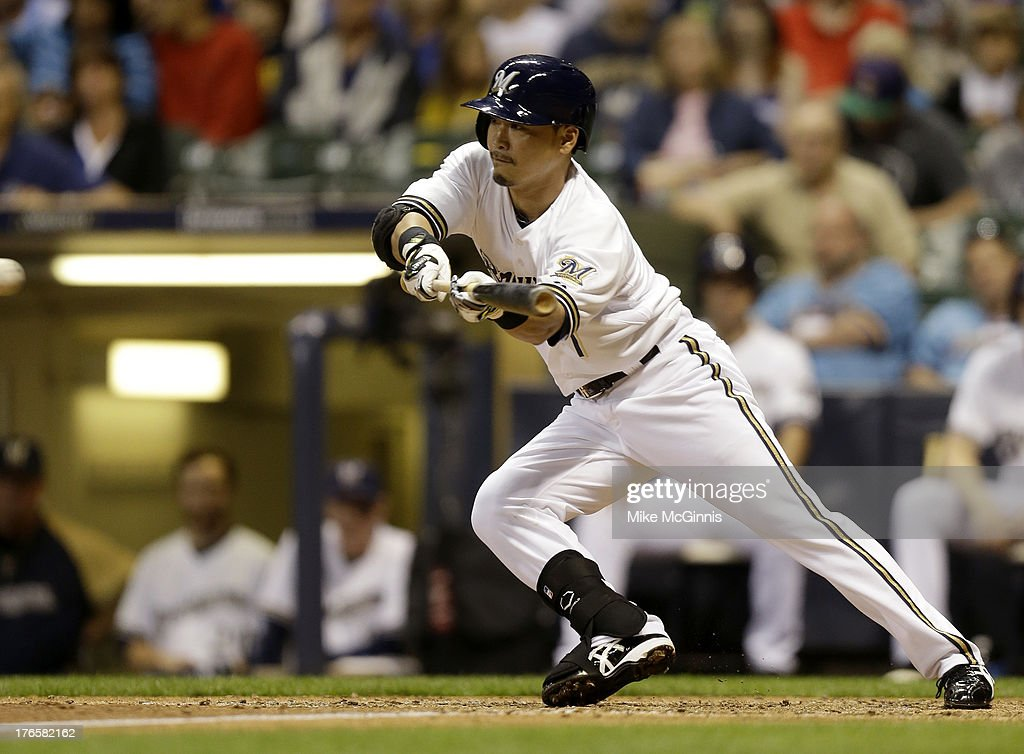 <a gi-track='captionPersonalityLinkClicked' href=/galleries/search?phrase=Norichika+Aoki&family=editorial&specificpeople=850957 ng-click='$event.stopPropagation()'>Norichika Aoki</a> #7 of the Milwaukee Brewers lays down a bunt for a hit in the bottom of the sixth inning against the Cincinnati Reds at Miller Park on August 15, 2013 in Milwaukee, Wisconsin.