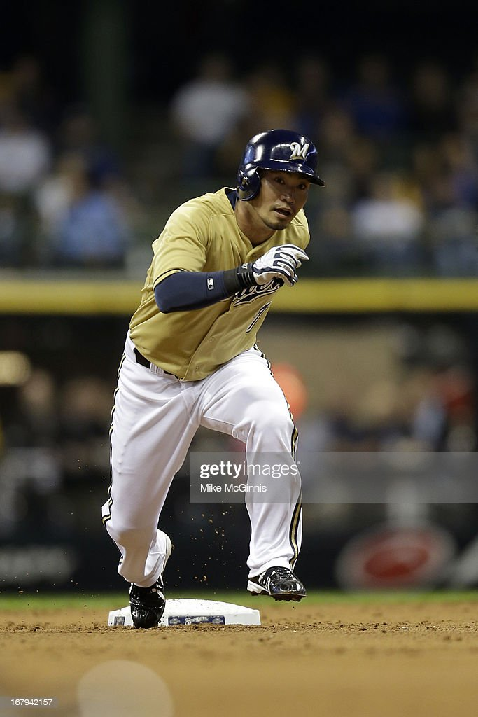 <a gi-track='captionPersonalityLinkClicked' href=/galleries/search?phrase=Norichika+Aoki&family=editorial&specificpeople=850957 ng-click='$event.stopPropagation()'>Norichika Aoki</a> #7 of the Milwaukee Brewers leads off at second base during the first inning against the St. Louis Cardinals at Miller Park on May 02, 2013 in Milwaukee, Wisconsin.