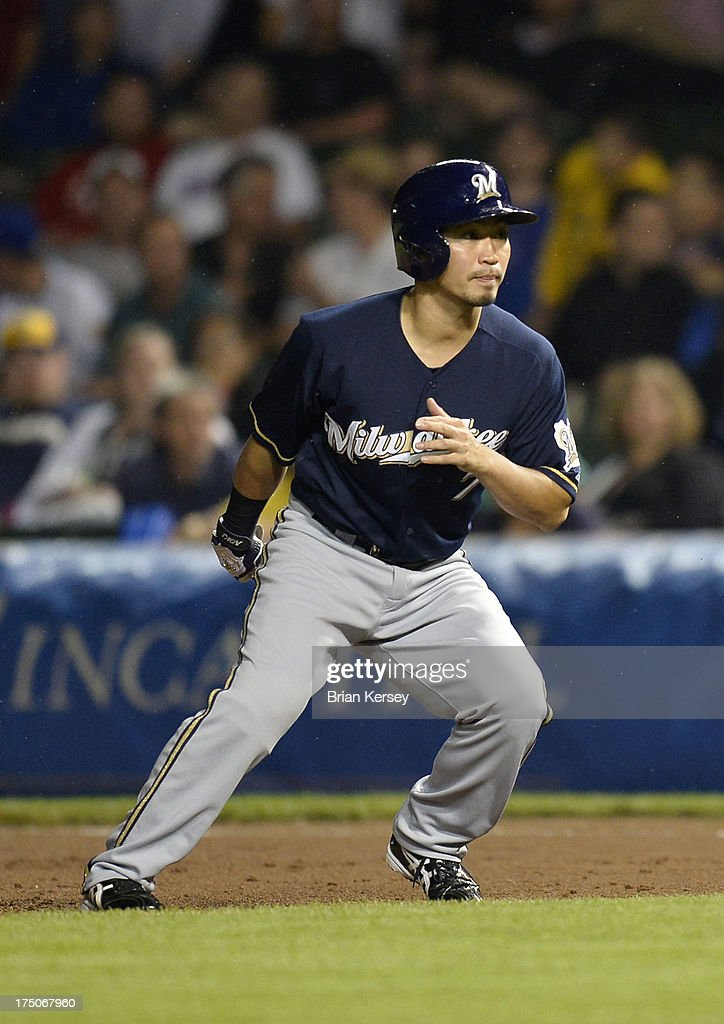 <a gi-track='captionPersonalityLinkClicked' href=/galleries/search?phrase=Norichika+Aoki&family=editorial&specificpeople=850957 ng-click='$event.stopPropagation()'>Norichika Aoki</a> #7 of the Milwaukee Brewers leads off first base during the ninth inning of Game Two of a double header against the Chicago Cubs at Wrigley Field on July 30, 2013 in Chicago, Illinois. Aoki came into the game as a pinch runner. The Brewers defeated the Cubs 3-2.