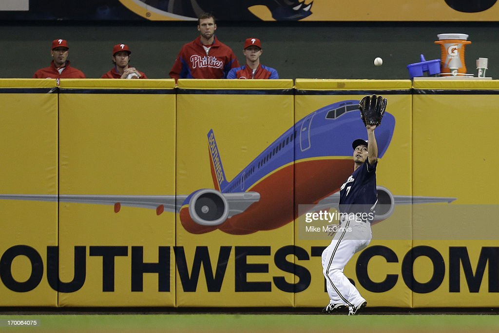 <a gi-track='captionPersonalityLinkClicked' href=/galleries/search?phrase=Norichika+Aoki&family=editorial&specificpeople=850957 ng-click='$event.stopPropagation()'>Norichika Aoki</a> #7 of the Milwaukee Brewers makes the catch in left field for an out in the top of the fourth inning against the Philadelphia Phillies during the game at Miller Park on June 06, 2013 in Milwaukee, Wisconsin.