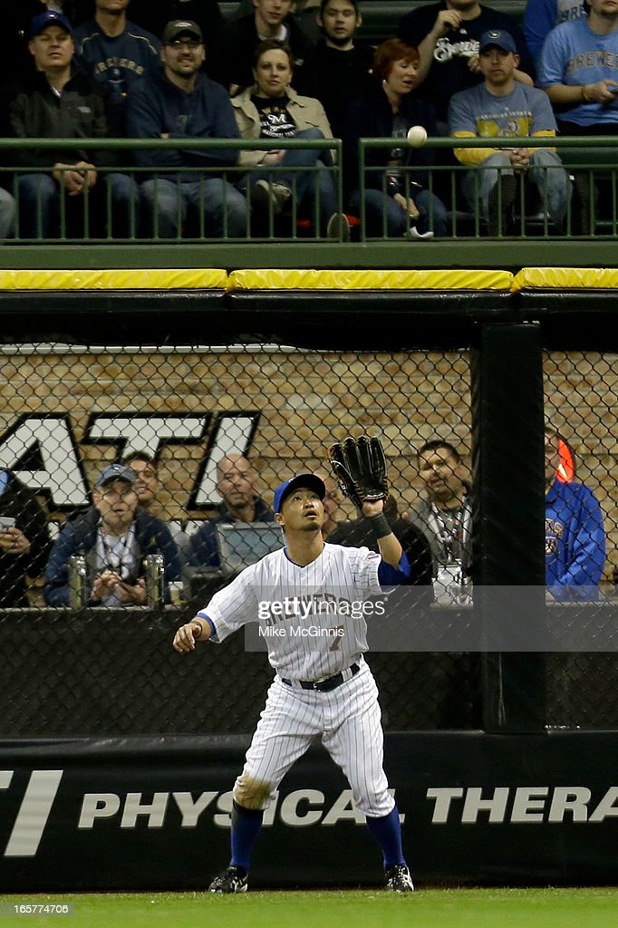 <a gi-track='captionPersonalityLinkClicked' href=/galleries/search?phrase=Norichika+Aoki&family=editorial&specificpeople=850957 ng-click='$event.stopPropagation()'>Norichika Aoki</a> #7 of the Milwaukee Brewers makes the catch in right field to retire Paul Goldschmidt of the Arizona Diamondbacks in the top of the eighth inning at Miller Park on April 5, 2013 in Milwaukee, Wisconsin.