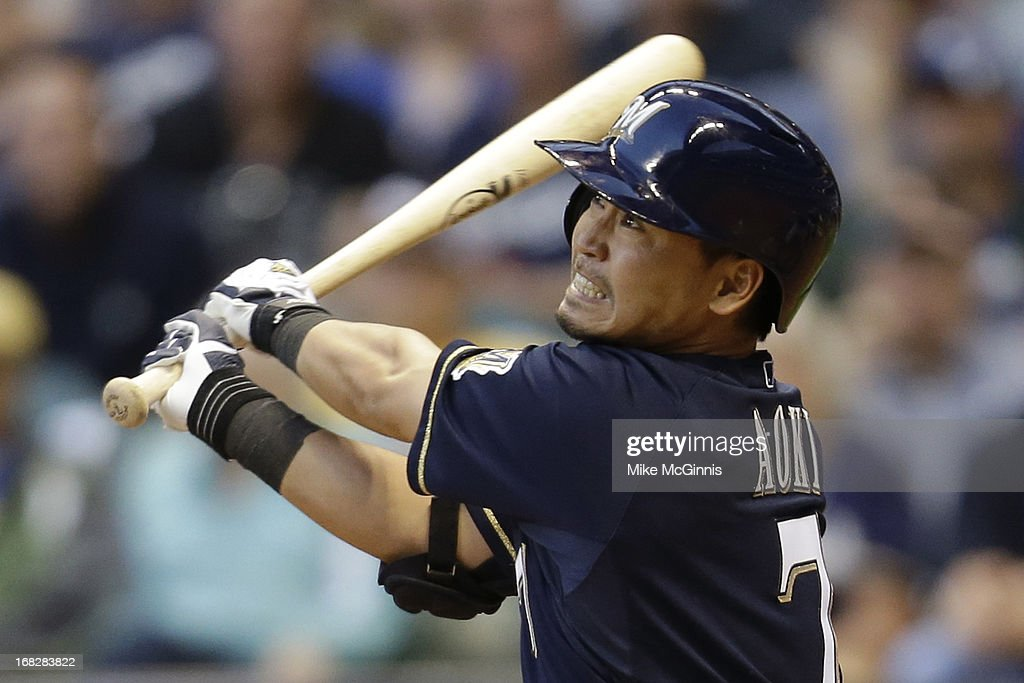 <a gi-track='captionPersonalityLinkClicked' href=/galleries/search?phrase=Norichika+Aoki&family=editorial&specificpeople=850957 ng-click='$event.stopPropagation()'>Norichika Aoki</a> #7 of the Milwaukee Brewers pops up to center field in the bottom of the second inning against the Texas Ranger at Miller Park on May 07, 2013 in Milwaukee, Wisconsin.