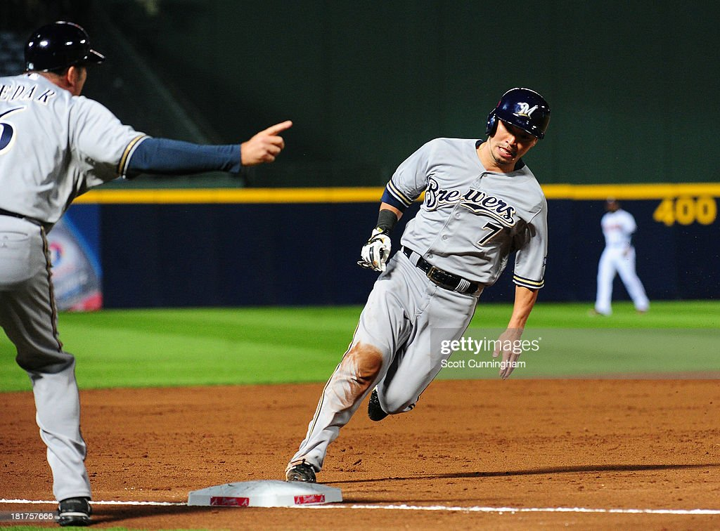 <a gi-track='captionPersonalityLinkClicked' href=/galleries/search?phrase=Norichika+Aoki&family=editorial&specificpeople=850957 ng-click='$event.stopPropagation()'>Norichika Aoki</a> #7 of the Milwaukee Brewers rounds third base to score a third inning run against the Atlanta Braves at Turner Field on September 24, 2013 in Atlanta, Georgia.