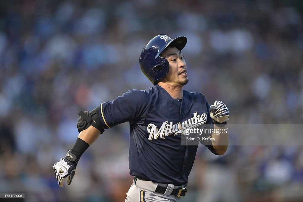 <a gi-track='captionPersonalityLinkClicked' href=/galleries/search?phrase=Norichika+Aoki&family=editorial&specificpeople=850957 ng-click='$event.stopPropagation()'>Norichika Aoki</a> #7 of the Milwaukee Brewers runs hard up the first base line as he tries to beat the throw to first base after hitting a ground ball during the third inning against the Chicago Cubs at Wrigley Field on July 31, 2013 in Chicago, Illinois. Aoki was out at first. The Cubs defeated the Brewers 6-1.