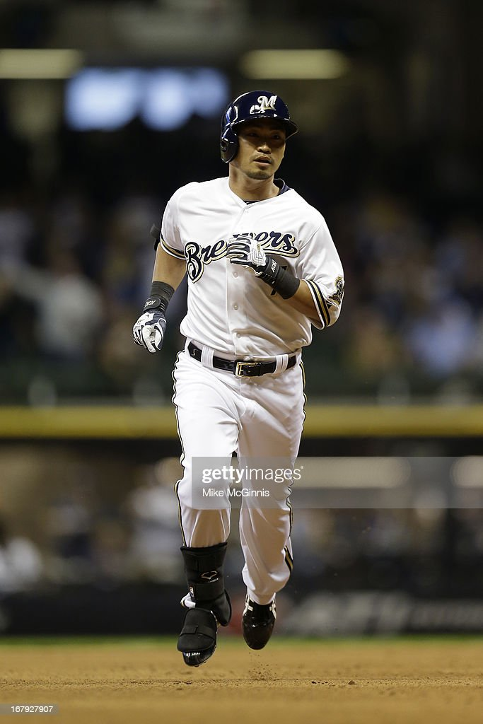 <a gi-track='captionPersonalityLinkClicked' href=/galleries/search?phrase=Norichika+Aoki&family=editorial&specificpeople=850957 ng-click='$event.stopPropagation()'>Norichika Aoki</a> #7 of the Milwaukee Brewers runs the bases after hitting a solo home run in the bottom of the fourth inning against the Pittsburgh Pirates during the game at Miller Park on April 29, 2013 in Milwaukee, Wisconsin.