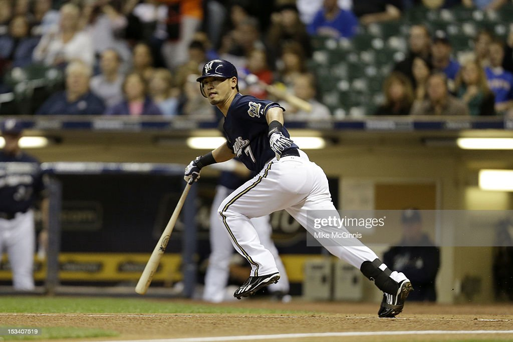 Norichika Aoki #7 of the Milwaukee Brewers runs to first base on contact during the game against the San Diego Padres at Miller Park on October 1, 2012 in Milwaukee, Wisconsin.
