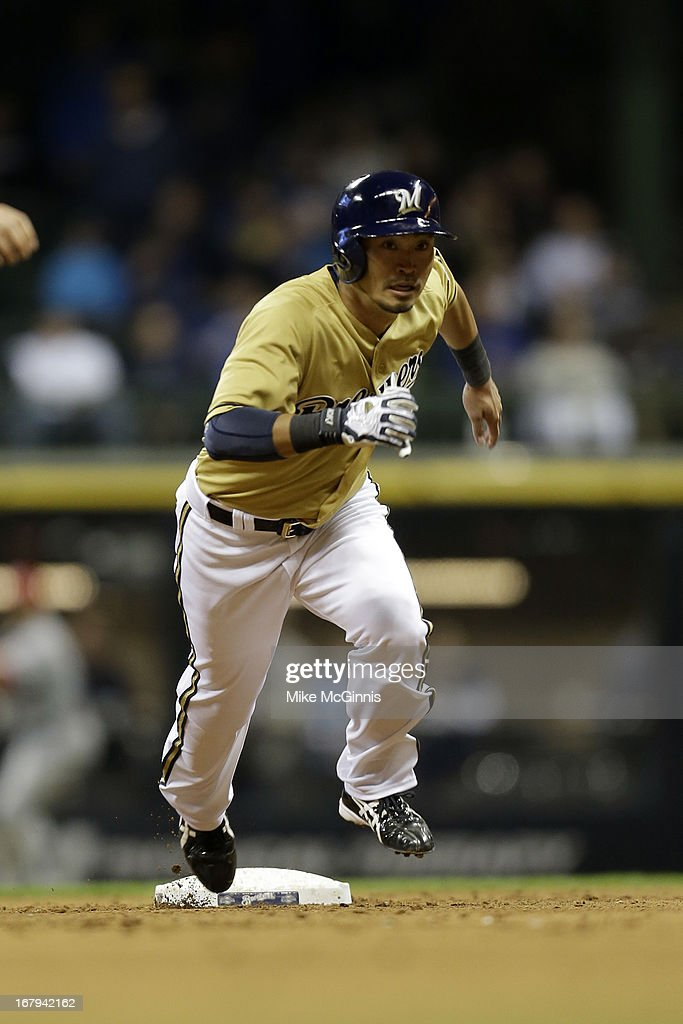 <a gi-track='captionPersonalityLinkClicked' href=/galleries/search?phrase=Norichika+Aoki&family=editorial&specificpeople=850957 ng-click='$event.stopPropagation()'>Norichika Aoki</a> #7 of the Milwaukee Brewers runs to third base in the bottom of the seventh inning against the St. Louis Cardinals at Miller Park on May 02, 2013 in Milwaukee, Wisconsin.