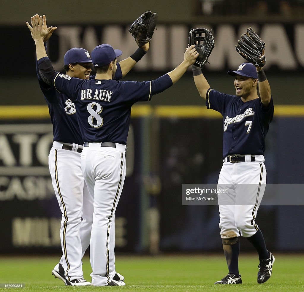 <a gi-track='captionPersonalityLinkClicked' href=/galleries/search?phrase=Norichika+Aoki&family=editorial&specificpeople=850957 ng-click='$event.stopPropagation()'>Norichika Aoki</a> #7 of the Milwaukee Brewers Ryan Braun #8 and Carlos Gomez #27 celebrate in the outfield after the 5-4 win over the Chicago Cubs at Miller Park on April 19, 2013 in Milwaukee, Wisconsin.