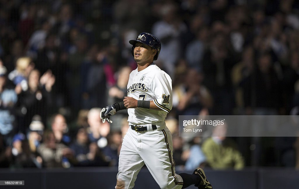 <a gi-track='captionPersonalityLinkClicked' href=/galleries/search?phrase=Norichika+Aoki&family=editorial&specificpeople=850957 ng-click='$event.stopPropagation()'>Norichika Aoki</a> #7 of the Milwaukee Brewers scores on a Ryan Braun #8 single in the eighth inning against the Colorado Rockies on opening day at Miller Park on April 1, 2013 in Milwaukee, Wisconsin. The Milwaukee Brewers defeated the Colorado Rockier 5-4.