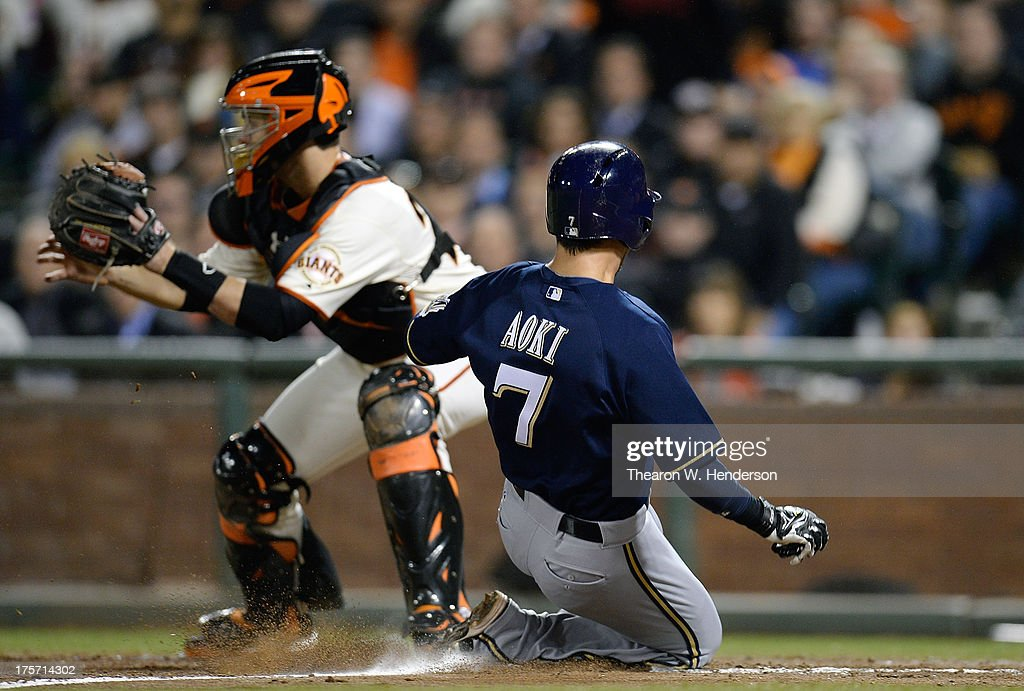 <a gi-track='captionPersonalityLinkClicked' href=/galleries/search?phrase=Norichika+Aoki&family=editorial&specificpeople=850957 ng-click='$event.stopPropagation()'>Norichika Aoki</a> #7 of the Milwaukee Brewers scores on a sacrifice fly from Jonathan Lucroy #20 (not pictured) beating the throw to Buster posey #28 of the San Francisco Giants in the ninth inning at AT&T Park on August 6, 2013 in San Francisco, California. The Brewers won the game 3-1.