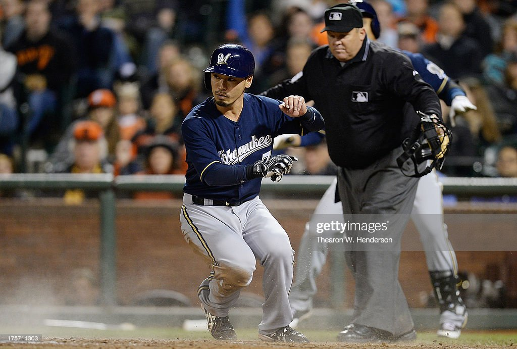 <a gi-track='captionPersonalityLinkClicked' href=/galleries/search?phrase=Norichika+Aoki&family=editorial&specificpeople=850957 ng-click='$event.stopPropagation()'>Norichika Aoki</a> #7 of the Milwaukee Brewers scores on a sacrifice fly from Jonathan Lucroy #20 in the ninth inning against the San Francisco Giants at AT&T Park on August 6, 2013 in San Francisco, California. The Brewers won the game 3-1.