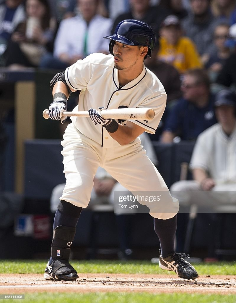 <a gi-track='captionPersonalityLinkClicked' href=/galleries/search?phrase=Norichika+Aoki&family=editorial&specificpeople=850957 ng-click='$event.stopPropagation()'>Norichika Aoki</a> #7 of the Milwaukee Brewers shows bunt against the St Louis Cardinals in the first inning at Miller Park on May 5, 2013 in Milwaukee, Wisconsin.