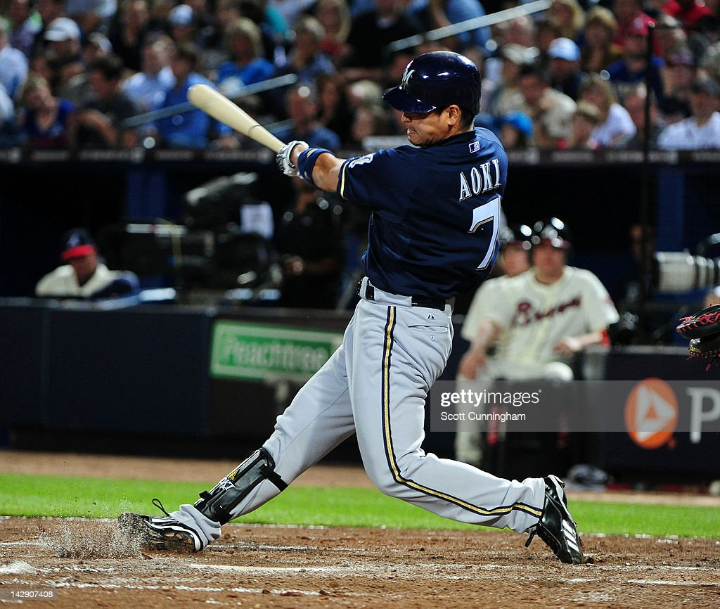 <a gi-track='captionPersonalityLinkClicked' href=/galleries/search?phrase=Norichika+Aoki&family=editorial&specificpeople=850957 ng-click='$event.stopPropagation()'>Norichika Aoki</a> #7 of the Milwaukee Brewers singles against the Atlanta Braves at Turner Field on April 14, 2012 in Atlanta, Georgia.